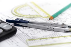 Architectural project, pair of compasses, rulers and calculator Royalty Free Stock Images