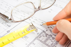 Architectural project. Pencil in hand and ruler close up, horizontal. Plan of construction concept stock photography