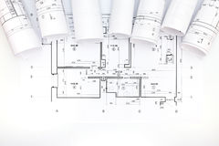 Architectural project and scrolls blueprint plans Royalty Free Stock Photos