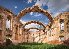 Architectural remains with prominent arches at sunny day