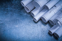 Architectural rolled up construction drawings on Royalty Free Stock Photography
