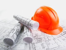 Architectural rols and helmet Stock Image