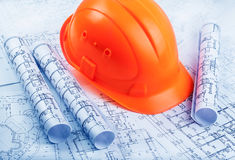 Architectural rols and helmet Royalty Free Stock Photos