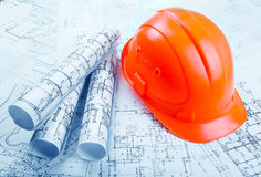 Architectural rols and helmet Stock Photography