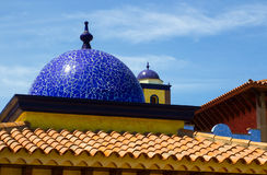 Architectural rooftops in Playa Las Americas in Teneriffe featuring tiled mosaic domes and terracotta tiles in retro Moorish style. And design. This beautiful Stock Images