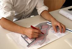 Architectural sketch. Architect in his studio sketching a stair detail on tracing paper Royalty Free Stock Photos
