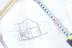 Architectural sketch of a house. And a key and a meter placed over the paper Stock Photos