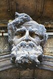 Architectural stone male head statue in Venice, Italy Royalty Free Stock Image