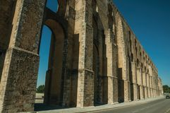 Architectural structure of aqueduct with arches and rectangular pillars. Architectural structure of the Amoreira Aqueduct with arches and rectangular pillars on stock image