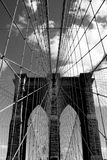 Architectural structures of Brooklyn Bridge. Dramatic black and white photograph of architectural elements of New York City historic Brooklyn Bridge in the Stock Images