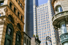Architectural styles. New York City, USA - May 19, 2014: Some old and new buildlings in manhattan in one picture Royalty Free Stock Images