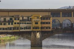 Architectural view at day time of Ponte Vecchio bridge in Florence royalty free stock photography