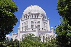 Architectural Wonder. The Bahai Temple, House of Worship in Wilmette, IL, framed by large trees Royalty Free Stock Photo