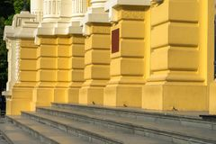Architectural yellow columns of old building.  Royalty Free Stock Images