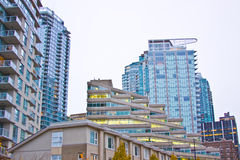 Architecture. High rise architecture in Vancouver, Canada. Glass condominium towers. A series of odd shaped buildings Stock Photos