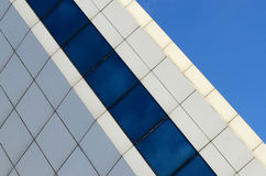 Architecture abstract blue glass wall on sky background Stock Photos