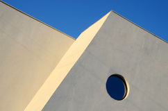 Architecture abstract wall with round window on blue sky Royalty Free Stock Images