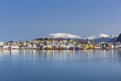 Architecture of Alesund town reflected in the water. Norway Stock Photo