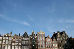 Architecture In Amsterdam. Buildings In Amsterdam And A Blue Sky royalty free stock photo