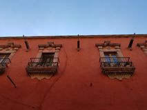 View of the exterior facade of an old house in San Miguel de Allende. Architecture and ancient construction, city with tradition and history of Mexico, travel Royalty Free Stock Image