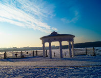 Architecture arch against the sky on  lake in winter. Architecture arch against the sky on the lake in winter Royalty Free Stock Images
