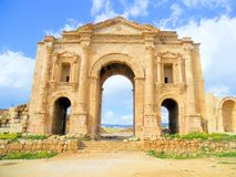 Architecture. The Arch of Hadrian in Jerash, Jordan is an 11-metre high triple-arched gateway erected to honor the visit of Roman Emperor Hadrian to the city in Stock Images
