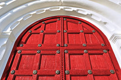 Architecture background - aged wooden door of red color Royalty Free Stock Photography