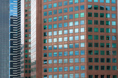 Architecture background of densely packed skyscrapers Stock Photos