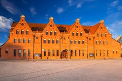 Architecture of the Baltic Philharmonic in Gdansk at sunrise, Poland. Royalty Free Stock Photo