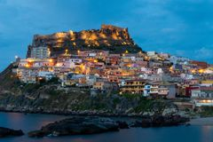 Castelsardo by night. colorfull houses and lights. Beautiful panoramic view of Medieval town of Castelsardo at evening night, Province of Sassari, Sardinia stock images