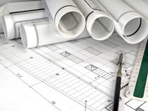 Architecture Blueprints. A closeup of an architect's desktop with blueprints and rolled design plans Stock Photo