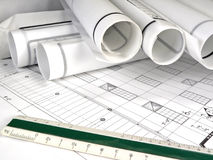 Architecture Blueprints. A closeup of an architect's desktop with blueprints and rolled design plans Royalty Free Stock Image