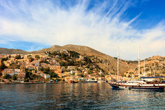 Architecture and boats on the Greek island of Symi. Stock Image
