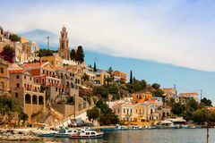 Architecture and boats on the Greek island of Symi. Stock Photos