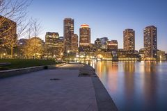 Boston. The architecture of Boston in Massachusetts, USA at night showcasing the historic buildings mixed with contemporary ones at Boston Harbor and Financial Stock Image