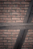 Architecture. Brick wall with wooden beams background Stock Photography