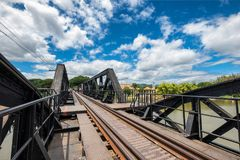 Architecture bridge over River Kwai historic of world war II wit. H chinese temple and blue sky Royalty Free Stock Photo