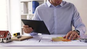 Architect with tablet pc, blueprint and palettes stock video footage