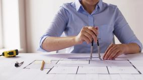 Female architect with compass measuring blueprint stock footage