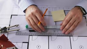 Architect hands with ruler measuring blueprint stock video