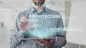 Architecture, building, design, construction, blueprint word cloud made as hologram used on tablet by bearded man, also royalty free illustration