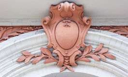 Architecture building element. Stucco coat of arms Stock Photography