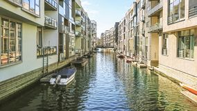 Architecture and buildings of Copenhagen street with moorings for small boats by canals in the water of a canal, Denmark. stock photo