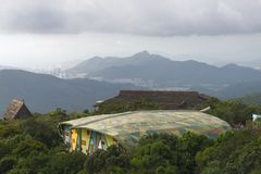 Architecture with Camouflage roof in forest on mountain. At national park , yalongwan, sanya, China. city built in valley stock photos