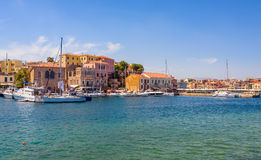 Architecture of Chania harbour with yachts and fishing boats on Crete island. Stock Photos