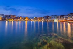 Architecture of Chania at night with Old Venetian port on Crete Stock Photos