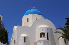 Architecture church in Santorini. Architecturel dome church in Santorini in blue and white in Santorini on a sunny sommer holiday royalty free stock photos