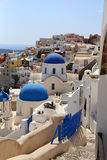 Architecture churches in Santorini with a wiew over the town. Royalty Free Stock Photo