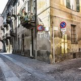 Architecture of the City of Cuneo. Architecture of the Medieval Piedmont City of Cuneo in Italy. Vintage Italian lamps and balconies in Mediterranean style Stock Images