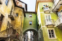 Architecture of the City of Cuneo. Architecture of the Medieval Piedmont City of Cuneo in Italy. Vintage Italian lamps and balconies in Mediterranean style Royalty Free Stock Photography